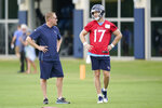 Tennessee Titans quarterback Ryan Tannehill (17) talks with offensive coordinator Todd Downing during NFL football practice Thursday, June 3, 2021, in Nashville, Tenn. (AP Photo/Mark Humphrey, Pool)