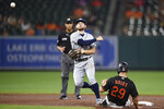 As as Baltimore Orioles' Ramon Urias (29) slides, Tampa Bay Rays second baseman Brandon Lowe, front left, throws to first to complete a double play on a ground ball hit by Pedro Severino in the sixth inning of baseball game, Friday, Aug. 27, 2021, in Baltimore. (AP Photo/Gail Burton)
