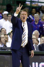 Kansas head coach Bill Self calls a play from the bench against Baylor during the second half of an NCAA college basketball game on Saturday, Feb. 22, 2020, in Waco, Texas. (AP Photo/Ray Carlin)