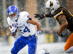 Air Force running back Kadin Remsberg (24) moves the ball across the field as Wyoming free safety Marcus Epps (6) moves in for a tackle during an NCAA college football game at War Memorial Stadium Saturday, Nov. 17, 2018, in Laramie, Wyo. (Josh Galemore/The Casper Star-Tribune via AP)