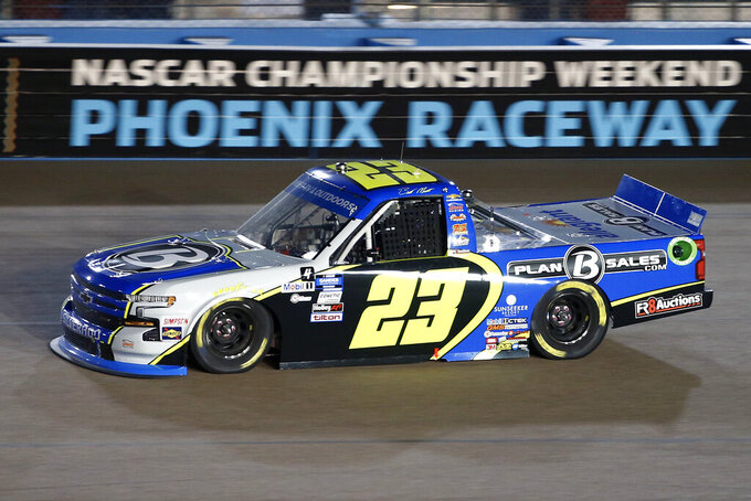 Brett Moffitt (23) races through Turn 4 during the NASCAR Truck Series auto race at Phoenix Raceway, Friday, Nov. 6, 2020, in Avondale, Ariz. (AP Photo/Ralph Freso)