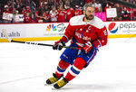 Washington Capitals left wing Alex Ovechkin (8), from Russia, skates during warmups before an NHL hockey game against the New Jersey Devils, Thursday, Jan. 16, 2020, in Washington. (AP Photo/Al Drago)