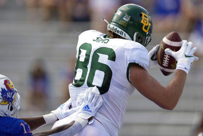 Baylor tight end Ben Sims (86) makes a touchdown catch in front of Kansas cornerback Ra'Mello Dotson (13) during the first half of an NCAA college football game in Lawrence, Kan., Saturday, Sept. 18 2021. (AP Photo/Orlin Wagner)