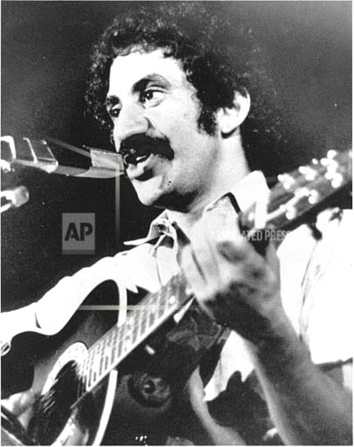 FILE- In this Sept. 21, 1973, file photo, singer Jim Croce performs in Natchitoches, La. After this appearance, he and five others were killed when their plane crashed near Natchitoches airport. (AP Photo/File)