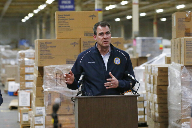 Oklahoma Governor Kevin Stitt answers a questions at a news conference at Oklahoma's Strategic National Stockpile warehouse in Oklahoma City, Tuesday, April 7, 2020, in Oklahoma City. Stitt said he is