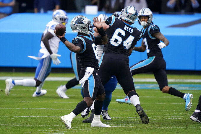 Carolina Panthers quarterback P.J. Walker throws his first NFL touchdown past during the second half of an NFL football game against the Detroit Lions Sunday, Nov. 22, 2020, in Charlotte, N.C. (AP Photo/Gerry Broome)