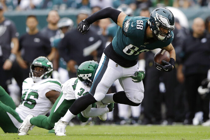 Philadelphia Eagles' Dallas Goedert, right, tries to break free from New York Jets' Brian Poole during the first half of an NFL football game, Sunday, Oct. 6, 2019, in Philadelphia. (AP Photo/Matt Rourke)