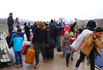 This photo provided on Jan. 30, 2020, by the Northern Democratic Brigade, a group of the US-backed Kurdish-led Syrian democratic forces, shows displaced Syrians who fled the Syrian military offensive in Idlib province, as they arrive in Manbij town, north Syria. Hundreds of thousands of Syrians have fled recent government bombardment of the last rebel bastion, the northwestern Idlib province, seeking shelter from harsh winter weather in muddy tents and half-constructed buildings. As government forces advance, areas deemed safe are rapidly shrinking. (Northern Democratic Brigade, via AP)