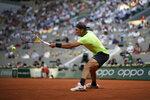 Spain's Rafael Nadal reruns the ball to Serbia's Novak Djokovic during their semifinal match of the French Open tennis tournament at the Roland Garros stadium Friday, June 11, 2021 in Paris. (AP Photo/Christophe Ena)