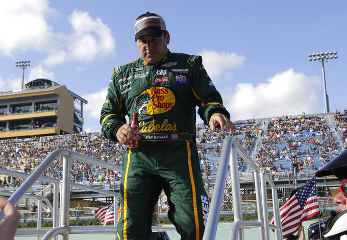 Ryan Newman walks to his car before the NASCAR Series Championship auto race at the Homestead-Miami Speedway, Sunday, Nov. 18, 2018, in Homestead, Fla. (AP Photo/Lynne Sladky)