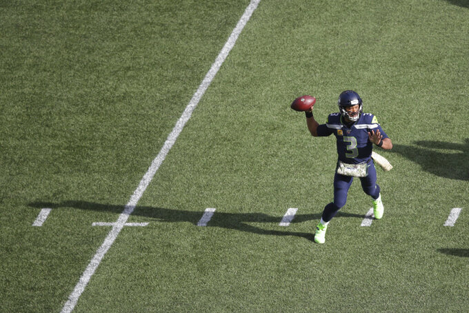 Seattle Seahawks quarterback Russell Wilson passes against the Tampa Bay Buccaneers during the first half of an NFL football game, Sunday, Nov. 3, 2019, in Seattle. (AP Photo/Scott Eklund)