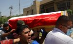 Mourners carry the flag-draped coffin of Hisham al-Hashimi during his funeral, in the Zeyouneh area of Baghdad, Iraq, Tuesday, July, 7, 2020. Al-Hashimi, an Iraqi analyst who was a leading expert on the Islamic State and other armed groups, was shot dead in Baghdad on Monday. (AP Photo/Khalid Mohammed)