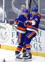 New York Islanders' Anders Lee (27) celebrates with Mathew Barzal after scoring a goal during the third period of the team's NHL hockey game against the Tampa Bay Lightning on Friday, Nov. 1, 2019, in Uniondale, N.Y. The Islanders won 5-2. (AP Photo/Frank Franklin II)