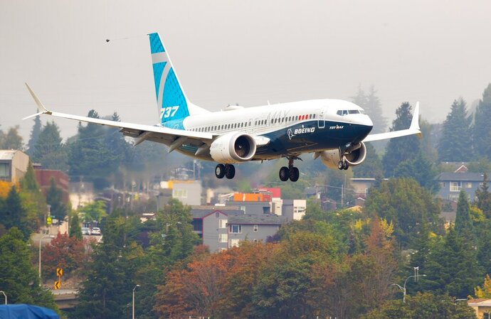 A Boeing 737 MAX lands at Boeing Field in Seattle on Wednesday, Sept. 30, 2020.  FAA chief Steve Dickson, a pilot who flew for the military and Delta Air Lines, was expected to sit in the captain's seat during a two-hour flight.  The Max has been grounded since March 2019, after the second crash. (Mike Siegel/The Seattle Times via AP, Pool)