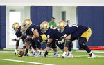 Notre Dame offensive lineman in three point stance during Notre Dame Fall Camp on Saturday, Aug. 7, 2021, at Irish Athletics Center in South Bend, Ind. (John Mersits/South Bend Tribune via AP)