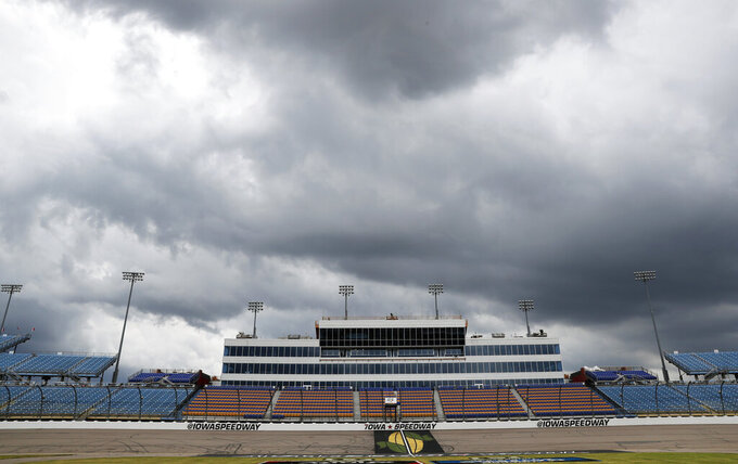 Storms clouds move in over the track before a NASCAR Truck Series auto race, Saturday, June 15, 2019, at Iowa Speedway in Newton, Iowa. (AP Photo/Charlie Neibergall)