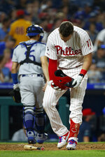 Philadelphia Phillies' Rhys Hoskins reacts after striking out against Los Angeles Dodgers relief pitcher Pedro Baez during the seventh inning of a baseball game, Tuesday, July 16, 2019, in Philadelphia. (AP Photo/Matt Slocum)