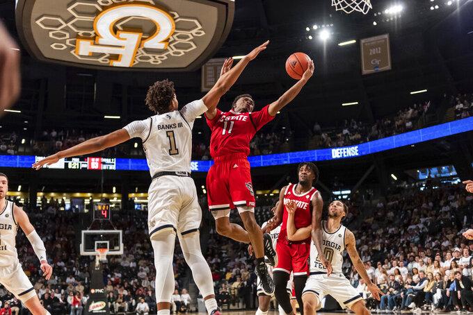 North Carolina State guard Dereon Seabron (1) shoots past Georgia Tech forward James Banks III (1) in the second half of an NCAA college basketball game Saturday, Jan. 25, 2020, in Atlanta. Georgia Tech won 64-58. (AP Photo/Danny Karnik)