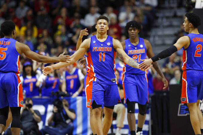 Florida forward Keyontae Johnson (11) celebrates with teammates after making a basket during a first round men's college basketball game against Nevada in the NCAA Tournament, Thursday, March 21, 2019, in Des Moines, Iowa. (AP Photo/Charlie Neibergall)