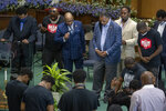 The Rev. Jesse L. Jackson, center right, is surrounded by faith leaders as they stand in prayer after he spoke to send a message of solidarity and demand justice in the death of George Floyd, at Greater Friendship Missionary Baptist Church, Thursday, May 28, 2020 in Minneapolis. (Elizabeth Flores/Star Tribune via AP)