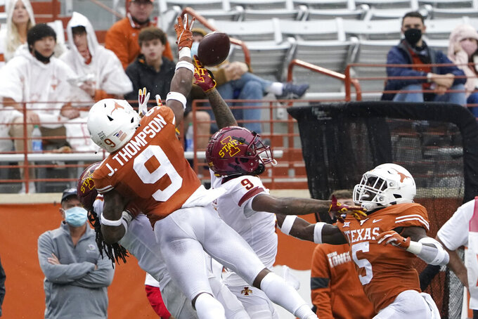 Texas defensive back Josh Thompson (9) breaks up a pass intended for Iowa State wide receiver Joe Scates (9) during the second half of an NCAA college football game, Friday, Nov. 27, 2020, in Austin, Texas. (AP Photo/Eric Gay)