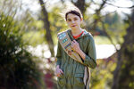 Olivia Chaffin, 14, stands for a portrait with her Girl Scout sash in Jonesborough, Tenn., on Sunday, Nov. 1, 2020. Olivia is asking Girl Scouts across the country to band with her and stop selling cookies, saying,