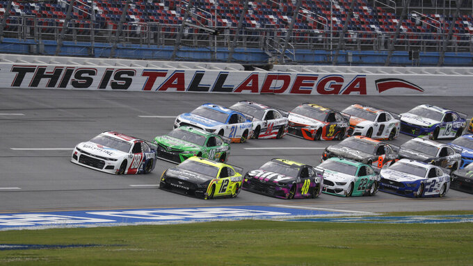 Ryan Blaney (12) takes the inside line during a restart of a NASCAR Cup Series auto race at Talladega Superspeedway in Talladega Ala., Monday, June 22, 2020. (AP Photo/John Bazemore)
