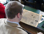 Kentucky state Rep. Brandon Reed, R-Hodgenville looks at a copy of the Tri Weekly Kentucky Yeoman from 1863 during a session of the legislature held at the Old State Capitol building in Frankfort, Ky., Tuesday, Feb. 19, 2019. The Old State Capitol Building, a National Historic Landmark was the center of Kentucky government from 1830 to 1910.(AP Photo/Timothy D. Easley)