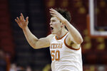 Texas center Will Baker (50) reacts after scoring against TCU during the first half of an NCAA college basketball game in Austin, Texas, Wednesday, Feb. 19, 2020. (AP Photo/Eric Gay)
