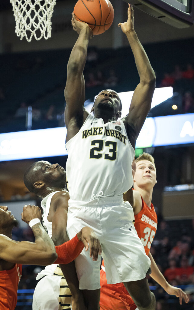 Wake Forest guard Chaundee Brown (23) shoots over Syracuse forward Oshae Brissett (11) and guard Buddy Boeheim (35) during the second half of an NCAA college basketball game, Saturday, March 2, 2019, at Joel Coliseum in Winston-Salem, N.C. (Allison Lee Isley/The Winston-Salem Journal via AP)