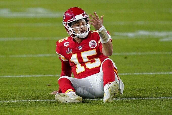 Kansas City Chiefs quarterback Patrick Mahomes sits on the field after a play against the Tampa Bay Buccaneers during the second half of the NFL Super Bowl 55 football game Sunday, Feb. 7, 2021, in Tampa, Fla. (AP Photo/Mark Humphrey)