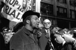 FILE - In this Oct. 29, 1969, file photo, Fred Hampton, center, chairman of the Illinois Black Panther party, speaks outside a rally outside the U.S. Courthouse in Chicago while Dr. Benjamin Spock, background, listens.