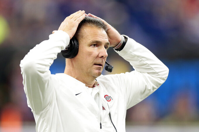 FILE - In this Dec. 1, 2018, file photo, Ohio State head coach Urban Meyer watches from the sidelines during the first half of the Big Ten championship NCAA college football game against Northwestern, in Indianapolis. Meyer had never seen the famous field at the Rose Bowl before this week. The Ohio State coach is wrapping up his career when the Buckeyes face the Washington Huskies in the 105th edition of the Granddaddy of Them All on Tuesday, Jan. 1, 2019.   (AP Photo/AJ Mast, File)