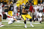 Iowa wide receiver Nico Ragaini, right, runs from Miami of Ohio defensive back Sterling Weatherford, left, after making a reception during the second half of an NCAA college football game, Saturday, Aug. 31, 2019, in Iowa City, Iowa. Iowa won 38-14. (AP Photo/Charlie Neibergall)