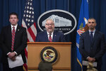 Assistant Attorney General Brian Benczkowski, center, in charge of the criminal division at the Dept. of Justice, U.S. Attorney Robert Duncan, of the Eastern District of Kentucky, left, and FBI Special Agent George Piro, right, in charge of the FBI's Miami office, appears at a news conference to announce charges against ten former National Football League (NFL) players who are accused of defrauding an NFL health care program, at the Justice Department in Washington, Thursday, Dec. 12, 2019. (AP Photo/Cliff Owen)