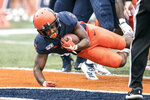 Illinois's Reggie Corbin dives into the end zone for his first touchdown of the season in the first half of an NCAA college football game against Akron, Saturday, Aug. 31, 2019, in Champaign, Ill. (AP Photo/Holly Hart)