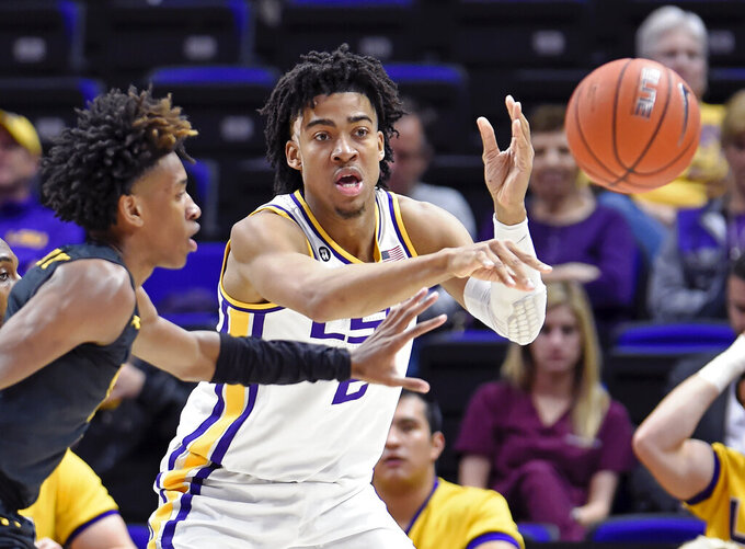 LSU forward Trendon Watford (2) makes the outlet pass as Maryland-Baltimore County guard Keondre Kennedy (0) applies pressure during the second half of an NCAA college basketball game Tuesday, Nov. 19, 2019, in Baton Rouge, La. LSU won 77-50. (AP Photo/Bill Feig)