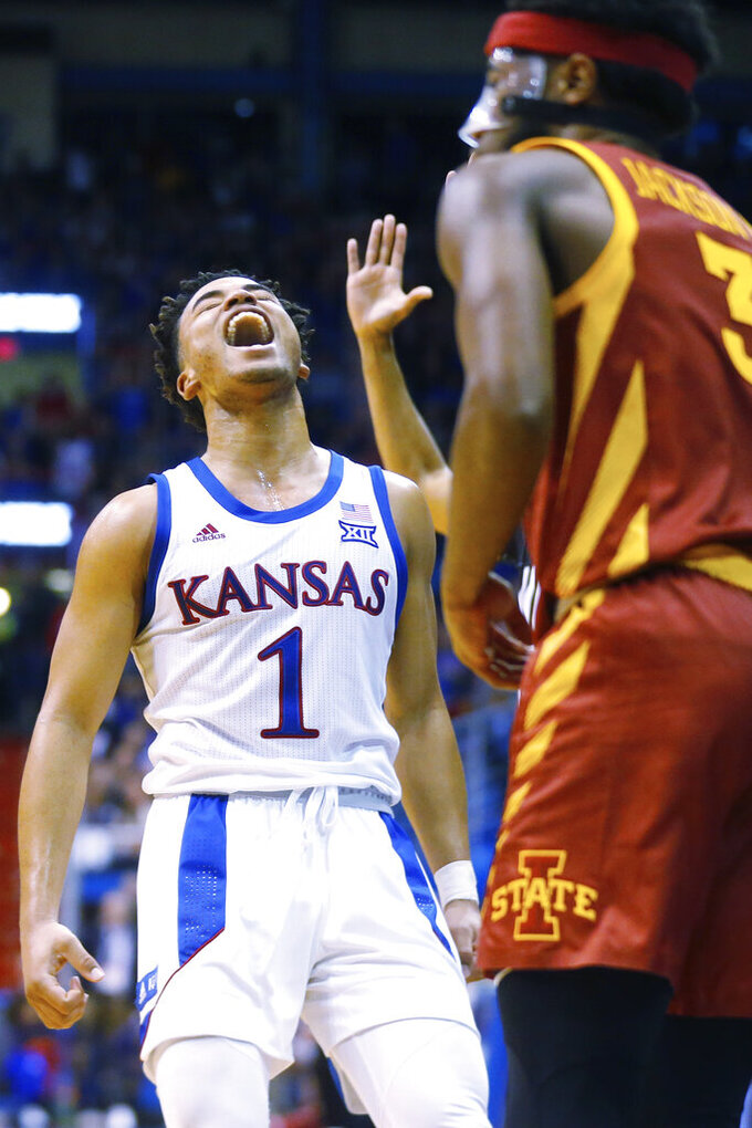 Kansas guard Devon Dotson celebrates after sinking a three-point shot in the second half of an NCAA college basketball game against Iowa State in Lawrence, Kan., Monday, Feb. 17, 2020. Kansas defeated Iowa State 91-71. (Evert Nelson/The Topeka Capital-Journal via AP)