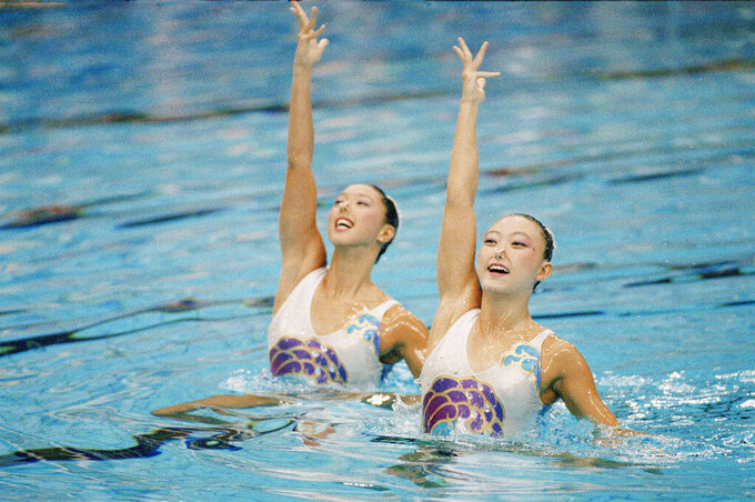 FILE - In this Sept. 27, 1977, file photo, Japan's Miyako Tanaka, right, and Mikako Kotani perform during women's synchronized swimming duet competition at the Olympic Games of the XXIV Olympiad in Seoul, South Korea. The organizing committee of the Tokyo 2020 Olympics announced Wednesday, Sept. 30, 2020, it has named Kotani as its new sports director. Kotani won two bronze medals in synchronized swimming - now called artistic swimming - at the the 1988 Olympics in Seoul. (AP Photo/Eric Risberg, File)