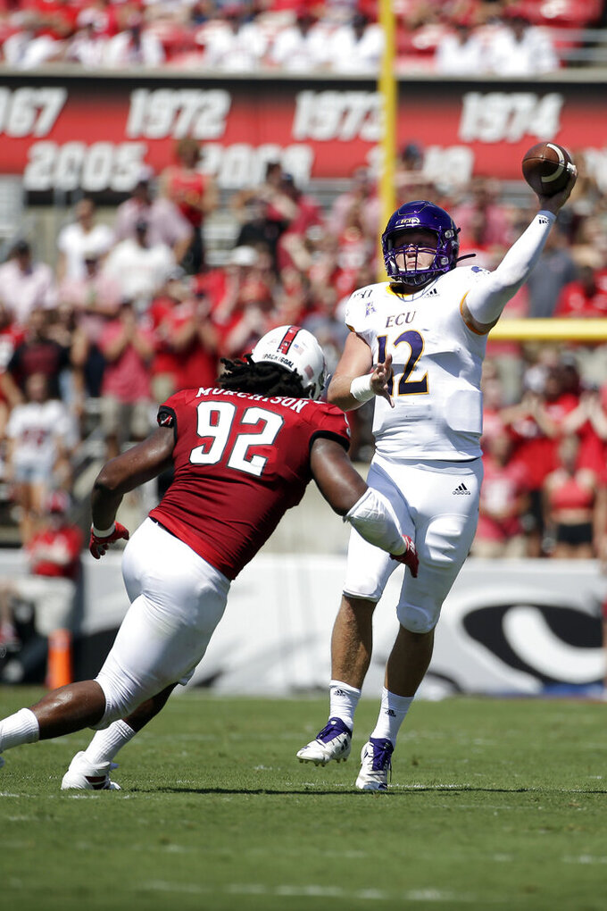 North Carolina State defensive tackle Larrell Murchison (92) rushes East Carolina quarterback Holton Ahlers (12) during the first half of an NCAA college football game in Raleigh, N.C., Saturday, Aug. 31, 2019. (AP Photo/Gerry Broome)