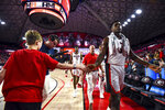 Georgia's Anthony Edwards (5) slaps hands with a young fan after the first half of the team's NCAA college basketball game against Georgia Southern on Monday, Dec. 23, 2019, in Athens, Ga. (Casey Sykes/Athens Banner-Herald via AP)