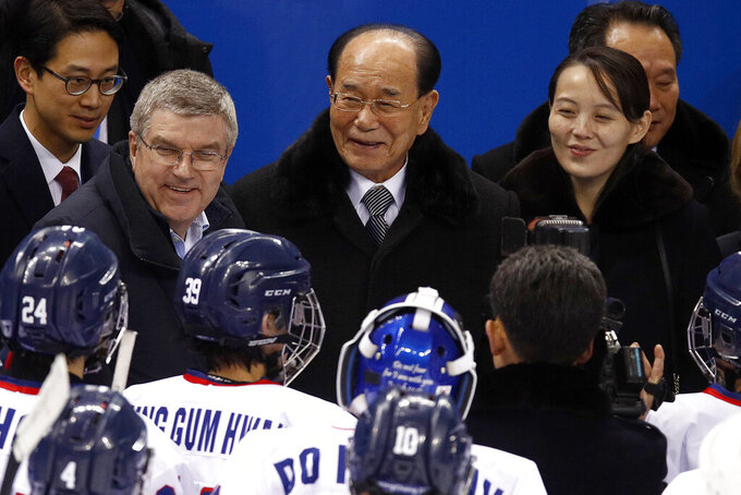 "FILE - In this Feb. 10, 2018, file photo, IOC president Thomas Bach, second from left, and Kim Yo Jong, right, sister of North Korean leader Kim Jong Un, talks with players after the preliminary round of the women's hockey game between Switzerland and the combined Koreas at the 2018 Winter Olympics in Gangneung, South Korea. North Korea has decided not to participate in this year's Olympic Games in Tokyo as it continues a self-imposed lockdown amid the coronavirus pandemic.  A website run by the North's Sports Ministry said the decision was made during a national Olympic Committee meeting on March 25, 2021 where members prioritized protecting athletes from the ""world public health crisis caused by COVID-19."" (AP Photo/Jae C. Hong, File)"