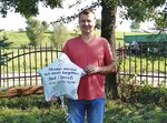 Radoslaw Gach, a Polish farmer, poses for a photo with a balloon that a woman in England released in memory of her father on the first anniversary of his death, in Troszkowo, Poland, on Sept. 11, 2019. The English woman wrote her phone number on the balloon and Gach's daughter Dominika helped him write a message in English to the woman in Birmingham, who was surprised that a balloon could travel more than 1,000 miles (1,700 kilometers). (AP Photo/Dominika Gach)