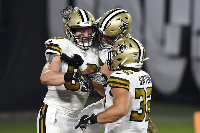 New Orleans Saints tight end Josh Hill (89) celebrates with teammates, including running back Michael Burton (32), after catching a 3-yard touchdown pass from quarterback Drew Brees during the second half of an NFL football game against the New Orleans Saints Sunday, Nov. 8, 2020, in Tampa, Fla. (AP Photo/Jason Behnken)