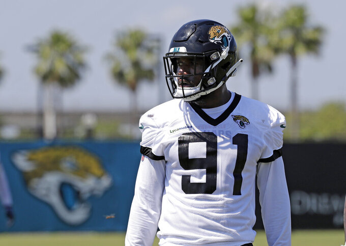 Ngakoue ends holdout, reports to Jags camp without new deal