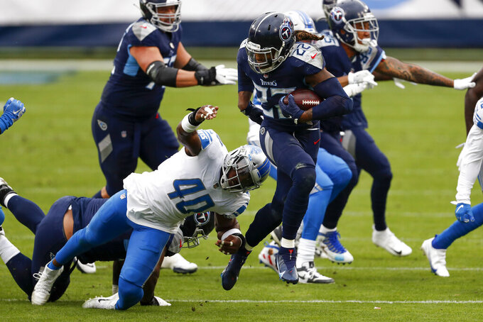 Tennessee Titans running back Derrick Henry (22) breaks away from Detroit Lions middle linebacker Jarrad Davis during the first half of an NFL football game Sunday, Dec. 20, 2020, in Nashville, Tenn. (AP Photo/Wade Payne)