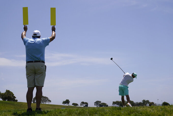 Brooks Koepka plays his shot from the second tee during a practice round of the U.S. Open Golf Championship, Tuesday, June 15, 2021, at Torrey Pines Golf Course in San Diego. (AP Photo/Jae C. Hong)