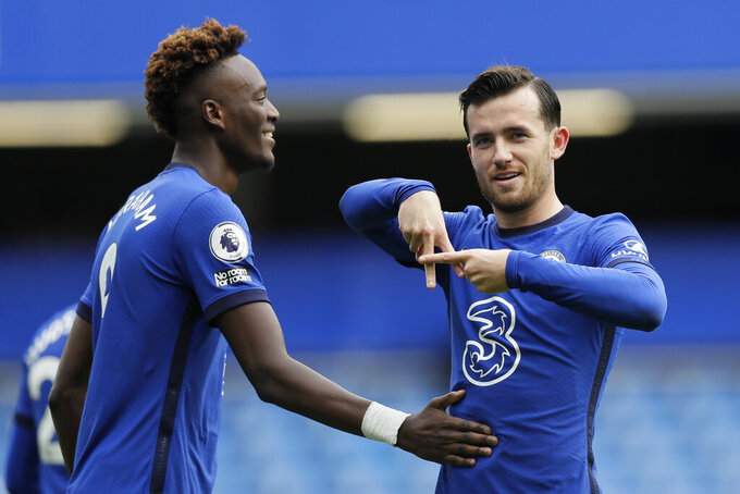 Chelsea's Ben Chilwell, right, celebrates with his teammate Tammy Abraham after he scored his side's first goal during the English Premier League soccer match between Chelsea and Crystal Palace at Stamford Bridge stadium in London, Saturday, Oct. 3, 2020. (AP Photo/Kirsty Wigglesworth, Pool)