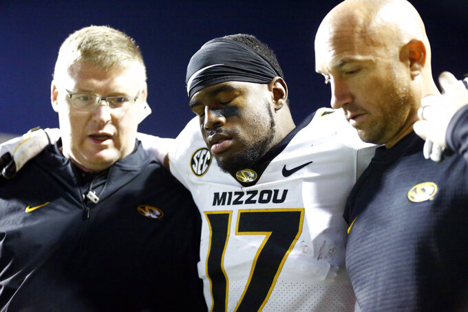 Missouri wide receiver Richaud Floyd (17) is helped off the field after being injured in the second half of an NCAA college football game against Tennessee Saturday, Nov. 17, 2018, in Knoxville, Tenn. (AP Photo/Wade Payne)