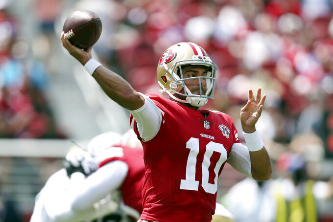 FILE - In this Sunday, Aug. 29, 2021, file photo, San Francisco 49ers quarterback Jimmy Garoppolo (10) throws a pass  during an NFL preseason football game against the Las Vegas Raiders in Santa Clara, Calif. Switching personnel mid-drive is commonplace in the NFL with running backs shuttling in and out and teams switching from three-receiver sets to two-receiver formations all the time. The 49ers could do it at quarterback this season with Garoppolo and rookie Trey Lance sharing time.  (AP Photo/Jed Jacobsohn, File)